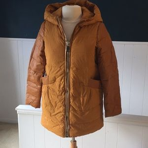 Down filled Coat with leather trim arms.